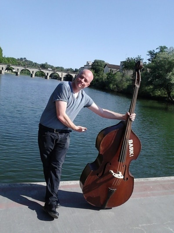 Jason Barnard holding his double bass